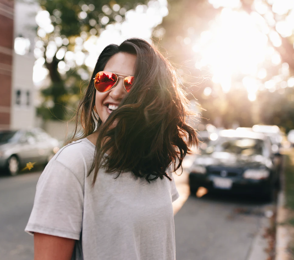 undergraduate grants, woman with red sunglasses standing on street